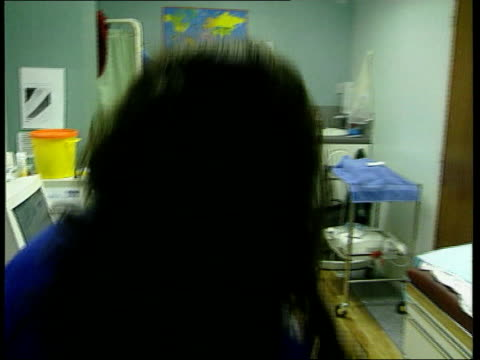 tenfold rise in autism in last decade lib mother carrying baby into consulting room of private clinic to receive separate doses of vaccinations... - mmr stock videos and b-roll footage