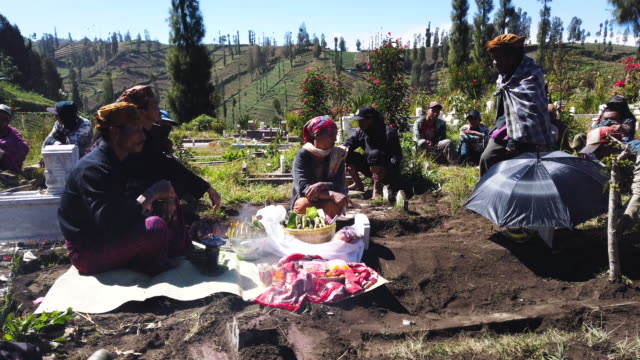 tenggerese children visit their ancestral cemetery as a part of haircut ceremony for teenagers who are known as 'tugel kuncung' avoiding misfortune... - tengger stock videos & royalty-free footage