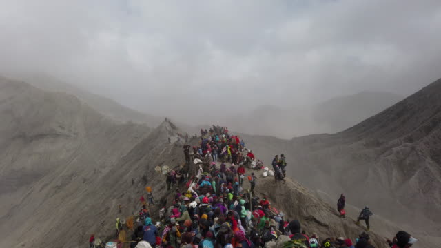 tenggerese gather at crater of mount bromo during the yadnya kasada festival on july 18 2019 in probolinggo east java indonesia tenggerese people are... - tengger stock videos & royalty-free footage