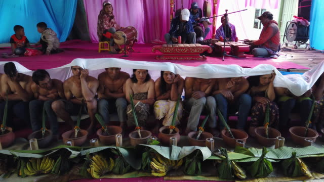 tenggerese people perform the traditional ceremony known 'entasentas' the death ceremony purifying the spirit of a deceased ancestor a part of... - tengger stock videos & royalty-free footage
