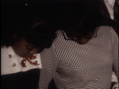 tennessee mother and daughter pray in memory of slain white postal worker william moore in chattanooga, before beginning the second freedom walk,... - white点の映像素材/bロール