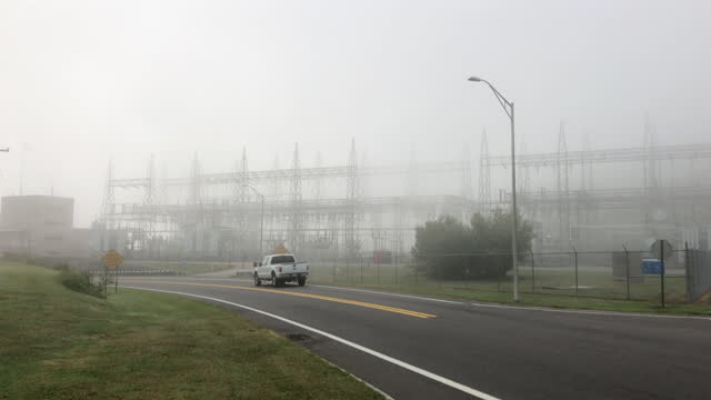 tennessee valley authority electricity systems in the dense fog amid the 2020 global coronavirus pandemic, the nuclear power plant is right next to... - tennessee stock videos & royalty-free footage