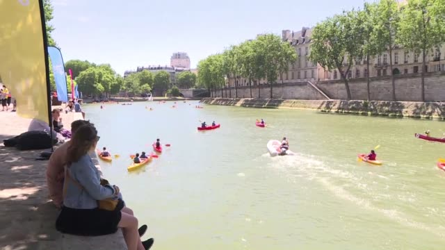 tennis at the hotel de ville kayaking on the seine paris goes all in for its celebration of olympic day as it gears up to host the 2024 summer games - hotel de ville paris stock videos & royalty-free footage