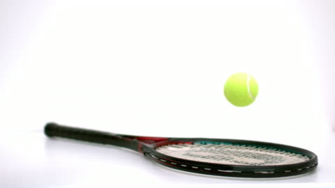 tennis ball bouncing on a racket - bouncing stock videos & royalty-free footage