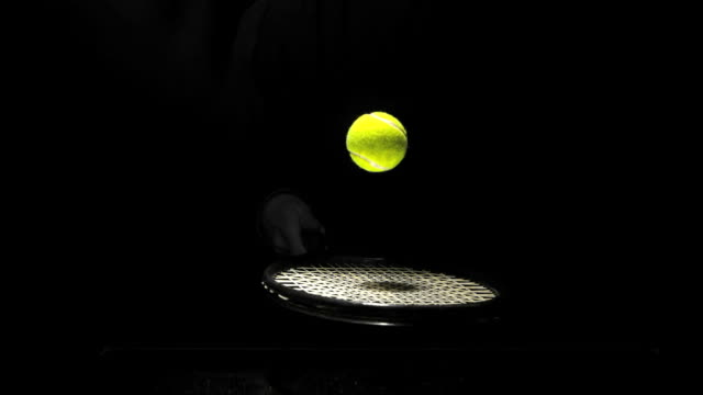vídeos de stock e filmes b-roll de tennis ball bouncing on a racket - bola de ténis