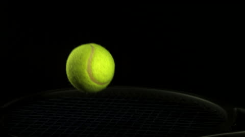 """""""tennis ball falling and bouncing against black background, slow motion"""" - two objects stock videos & royalty-free footage"""