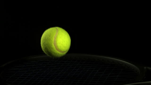 """""""tennis ball falling and bouncing against black background, slow motion"""" - calvados stock videos and b-roll footage"""