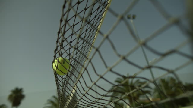 vídeos de stock e filmes b-roll de slo mo tennis ball hits net right to left, spain - bola de ténis