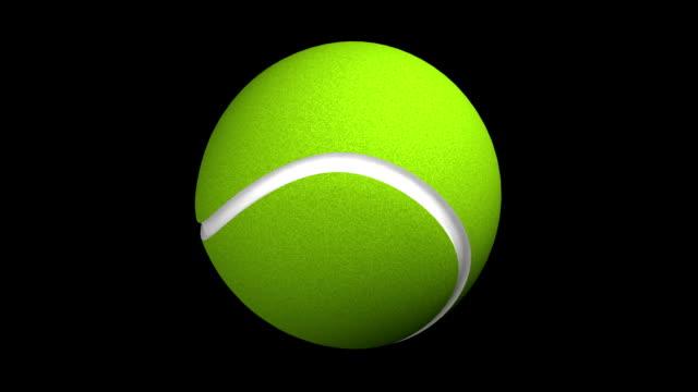 tennis ball rotation loop on black bg zg - tennis ball stock videos & royalty-free footage
