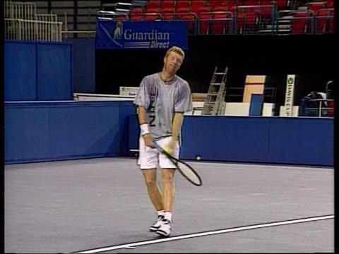birmingham davis cup; ulay itn england: birmingham: indoor arena: int greg rusedski , tim henman , jim courier and todd martin warming up on court - davis cup stock videos & royalty-free footage