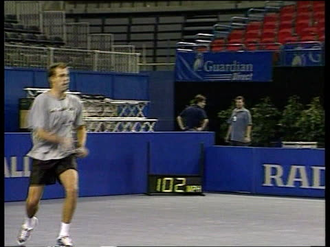 davis cup itn england birmingham indoor arena tim henman practising with greg rusedski henman rusedski standing for photocall wrapped in union jack... - davis cup stock videos & royalty-free footage