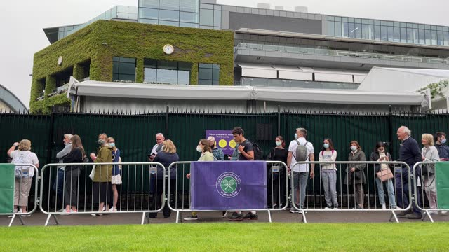 tennis fans queue to enter the wimbledon all england tennis club ahead of day one of the wimbledon tennis championships on june 27, 2021 in... - fan enthusiast stock videos & royalty-free footage