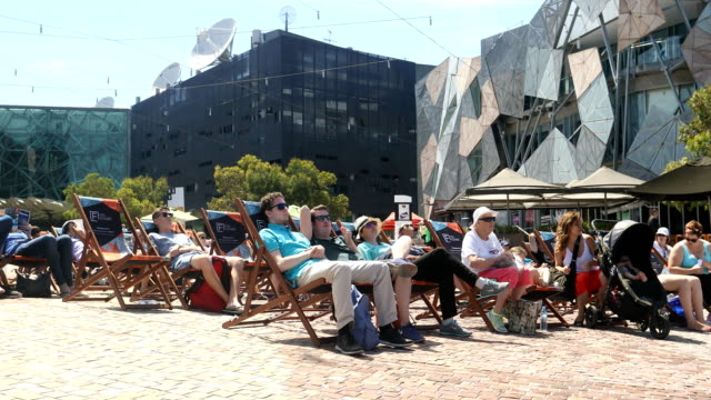 Tennis fans watch the tennis at Federation Square during the Australian Open on January 25 2017 in Melbourne Australia