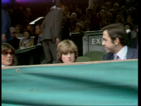 lady diana attends wimbledon england london wimbledon all england club ext lady diana seated in stands next to king constantine of greece zoom in - teilnehmen stock-videos und b-roll-filmmaterial