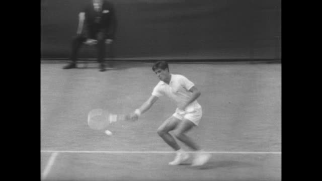 / tennis match between charlie pasarell of puerto ricoo and manuel martinez of spain at wimbledon / large crowd applauding pasarell's early lead /... - 1967 stock videos & royalty-free footage