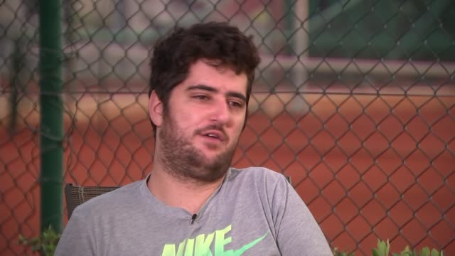 tennis matches targeted for match fixing; evening various of mikos playing tennis as reporter watches konstantinos mikos interview sot cutaway... - davis cup stock-videos und b-roll-filmmaterial