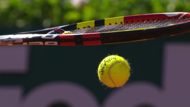 Tennis matches targeted for match fixing LOCATION Tennis racquet hitting tennis ball SLOW MOTION Feet of tennis player jumping into the air as...