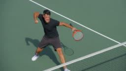 A Tennis Player Celebrates winning Game, Set and Match.