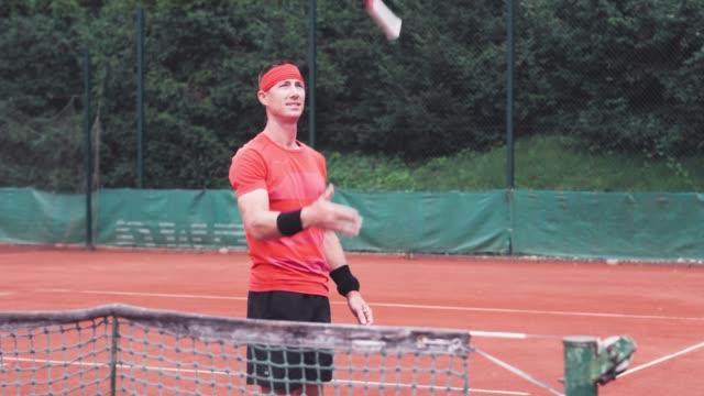 tennis player having some fun with tennis racket - tennis racket stock videos & royalty-free footage
