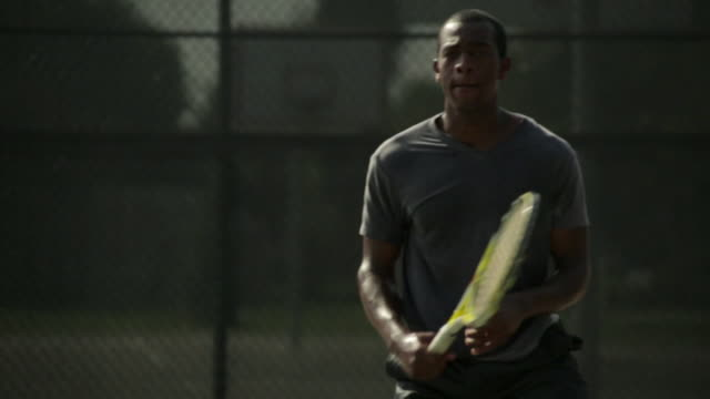 a tennis player hits a forehand return. - forehand stock videos & royalty-free footage