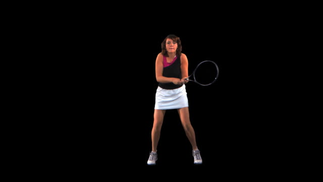 vídeos de stock, filmes e b-roll de tennis player hitting backhand - this clip has an embedded alpha-channel - codificável