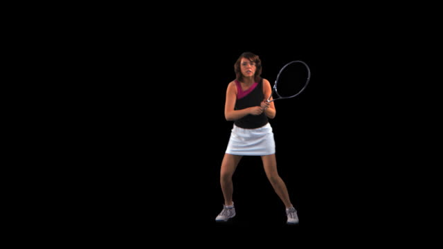 vidéos et rushes de tennis player hitting forehand - this clip has an embedded alpha-channel - sous passe partout