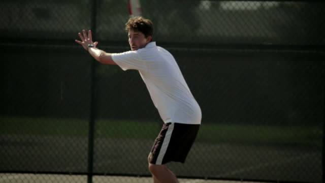 a tennis player practices a forehand stroke. - forehand stock videos & royalty-free footage