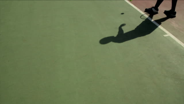 a tennis player serves a ball on a court. - serving sport stock videos and b-roll footage