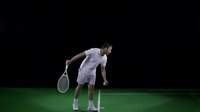 ws slo mo tennis player serving ball / berlin, germany - tennis stock videos & royalty-free footage