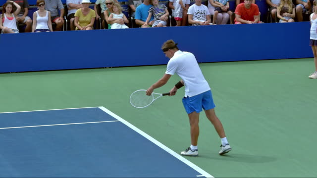 Tennis Player Serving The Ball