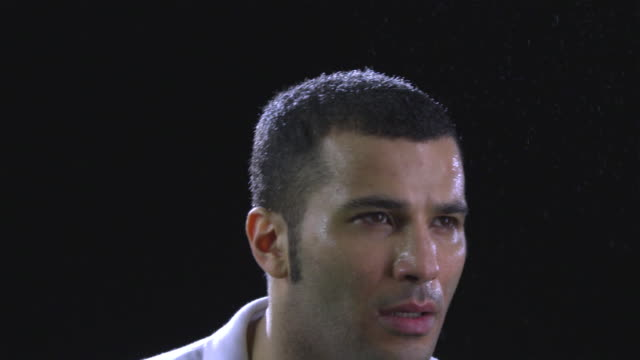 ecu slo mo tennis player sweating and wiping the sweat from his head / berlin, germany - extreme close up点の映像素材/bロール