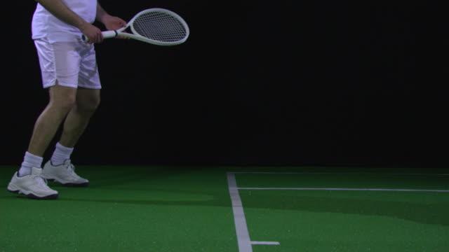 MS SLO MO Tennis player swinging racquet / Berlin, Germany