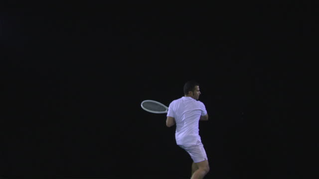 ws slo mo tennis player swinging racquet, clenching fist / berlin, germany - 揺らす点の映像素材/bロール