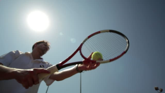 a tennis player tosses the ball up to serve it. - serving sport stock videos and b-roll footage
