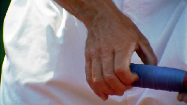 a tennis player turns his racquet in his hands. - racquet stock videos & royalty-free footage