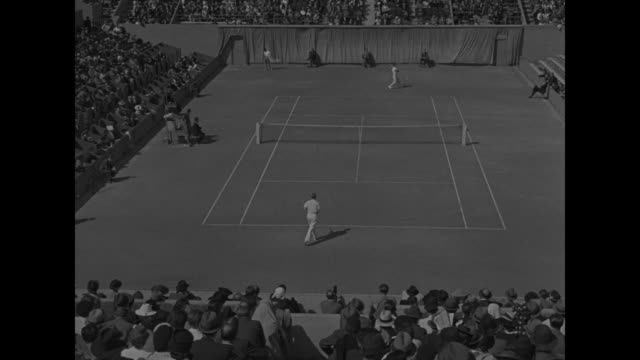 mcu tennis players bobby riggs and don mcneill on tennis court / ms riggs and mcneill crowd in stands in background / ls high angle of riggsmcneill... - flushing meadows corona park stock videos and b-roll footage