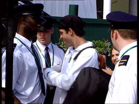 US Open Greg Rusedski LIB ENGLAND London Wimbledon EXT Greg Rusedski arriving for match posing to press and signs autographs
