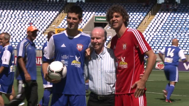 tennis world number one novak djokovic swapped his racket for a pair of football boots and joined brazilian former tennis world one gustavo kuerten... - tennis racket stock videos & royalty-free footage
