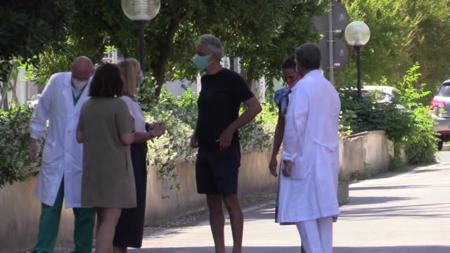 tenor andrea bocelli and wife veronica berti are seen arriving at the transfusion center of the cisanello hospital on may 26, 2020 in pisa, italy.... - andrea bocelli stock videos & royalty-free footage