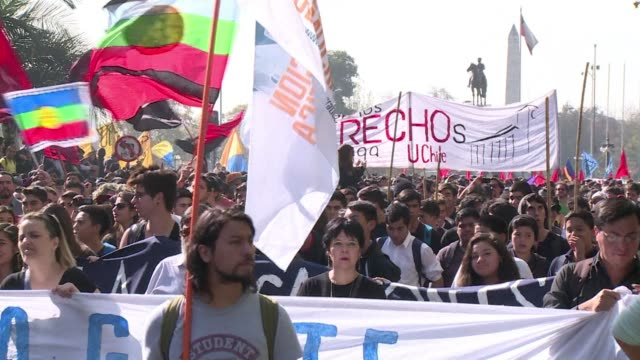 Tens of thousands of Chilean students protested Thursday in Santiago pressuring President Michelle Bachelet who was swept into office pledging...