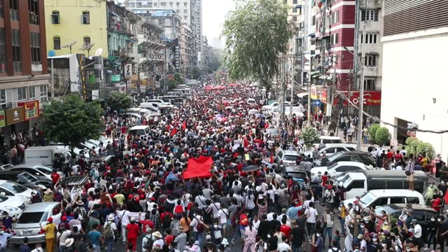 tens of thousands of demonstrators, mostly young people, staged four separate rallies against the military coup in myanmar on february 078, 2021 amid... - ミャンマー点の映像素材/bロール