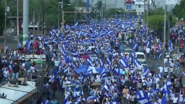 Tens of thousands of demonstrators take to Nicaragua's streets rallied by students demanding justice democracy and the departure of President Daniel...