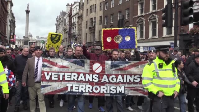 tens of thousands of football fans took part in a silent protest saturday against extremism in london's streets - extremism stock videos & royalty-free footage