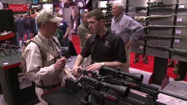 tens of thousands of gun enthusiasts and gun rights advocates gathered in st louis on friday to look over highpowered firearms and hear from some of... - national rifle association stock videos & royalty-free footage
