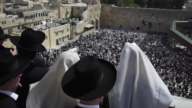 tens of thousands of jewish worshippers gathered monday at jerusalems western wall for the traditionnal priestly blessing prayer on the holiday of... - passover stock videos and b-roll footage