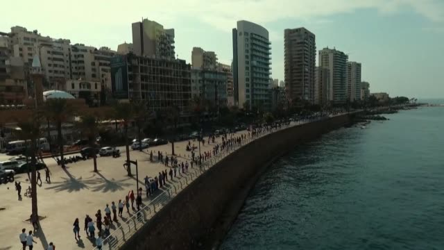 tens of thousands of lebanese protesters successfully form a human chain running north to south across the entire country to symbolise newfound... - lebanon country stock videos & royalty-free footage