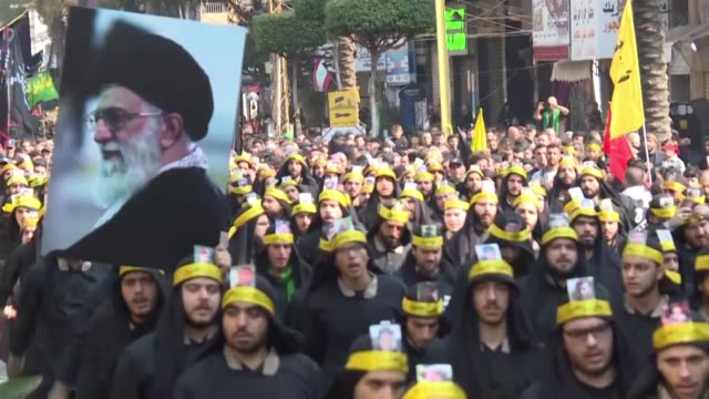 tens of thousands of lebanese shiite muslims walk the streets of beirut's southern suburbs to mark the 10th day of ashura's religious commemoration... - muharram stock videos & royalty-free footage