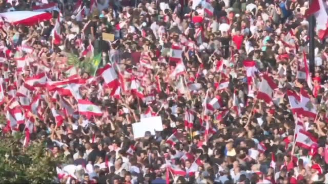 tens of thousands of lebanese take to the streets in cities across the country to demand the resignation of politicians they see as inept and corrupt... - lebanon country stock videos & royalty-free footage