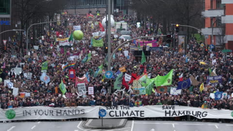 tens of thousands of marchers participate in a fridays for future climate protest on february 21, 2020 in hamburg, germany. the city-state of hamburg... - climate stock videos & royalty-free footage