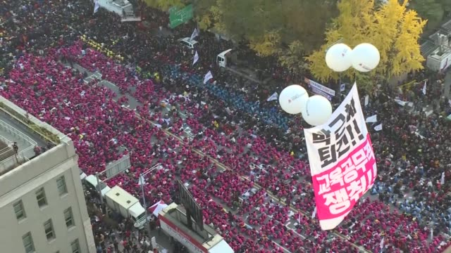 Tens of thousands of men women and children join one of the largest anti government protests seen in Seoul for decades demanding President Park...